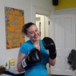 Jordan boxing at a weekly fitness class in Paxton Manor