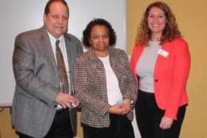 """2016 – Rick Berry (left) with Mary Kearney (middle) and Jennifer Lassiter, presenting the Rick Berry Professional of the Year Award honoring professionals who go beyond their responsibilities to help a person achieve """"A Life Like Yours."""""""